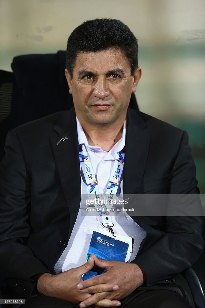 Coach Amir Ghalehnoy of Esteghlal loos on during the AFC Champions League Group D match between Esteghlal and Al Rayyan at Azadi Stadium on April 23, 2013 in Tehran, Iran.