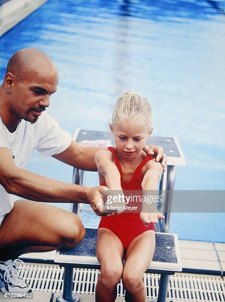 Coach and Girl at Swimming Pool