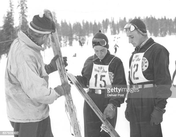Coach and pupils Coach Willy Schaeffler is giving two of his University of Denver skiers some of the fine points on taking care of their skis in this...