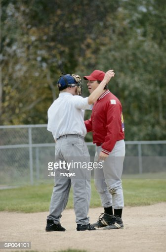 Coach and Umpire Argue over Baseball Game
