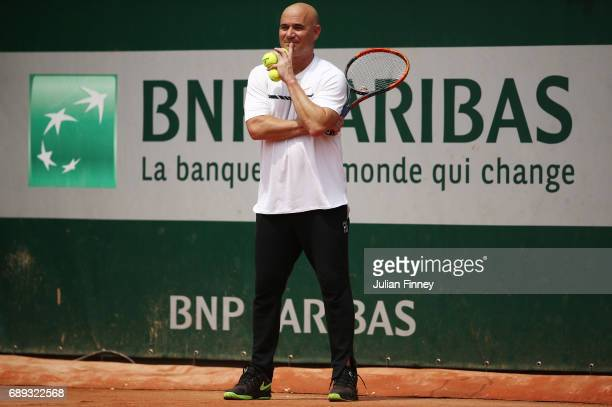 Coach Andre Agassi looks on as Novak Djokovic of Serbia practices on day one of the 2017 French Open at Roland Garros on May 28 2017 in Paris France