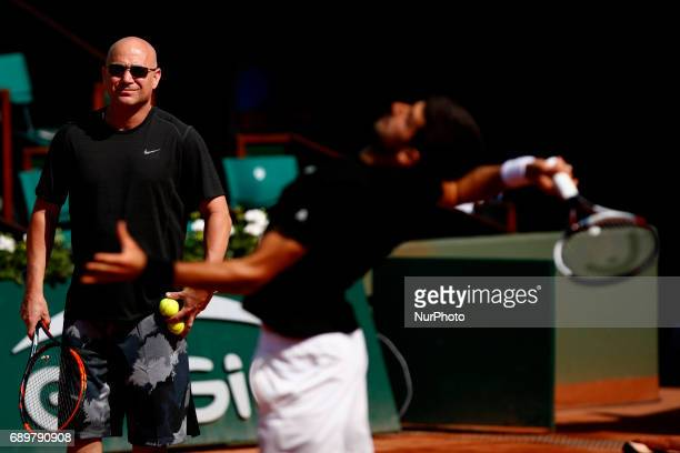 Coach Andre Agassi looks on as Novak Djokovic of Serbia practices on day two of the 2017 French Open at Roland Garros on May 29 2017 in Paris France