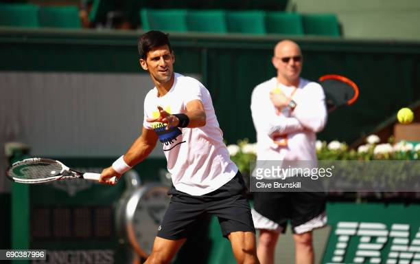 Coach Andre Agassi watches on during a Novak Djokovic training session prior to his match against Joao Sousa on day four of the 2017 French Open at...