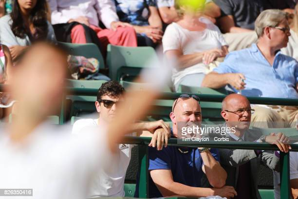 Coach Andre Agassi watching Novak Djokovic of Serbia in action against Tomas Berdych of the Czech Republic in the Mens' Singles Quarter Final match...