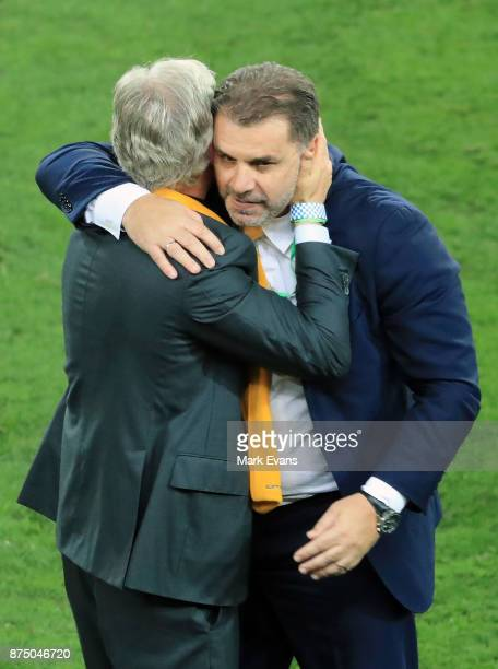 Coach Ange Postecoglou is hugged after Australia's win in the 2018 FIFA World Cup Qualifiers Leg 2 match between the Australian Socceroos and...