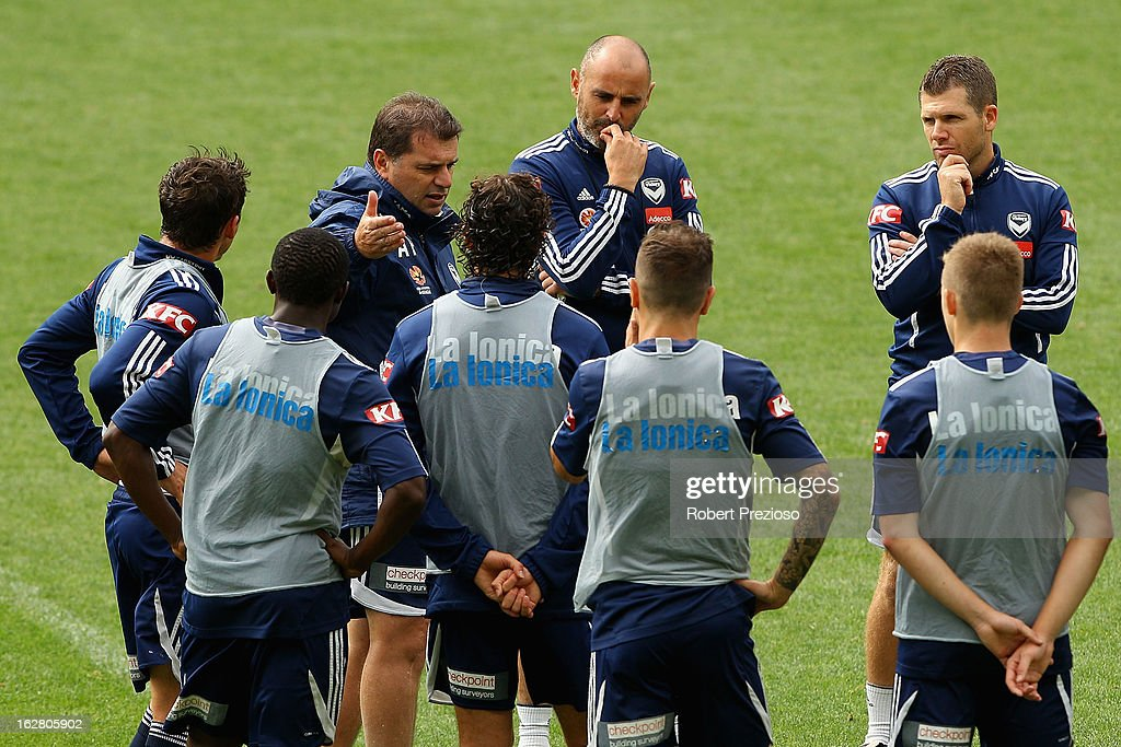 Coach Ange Postecoglou talks to players during a Melbourne Victory A-League training session at AAMI Park on February 28, 2013 in Melbourne, Australia.