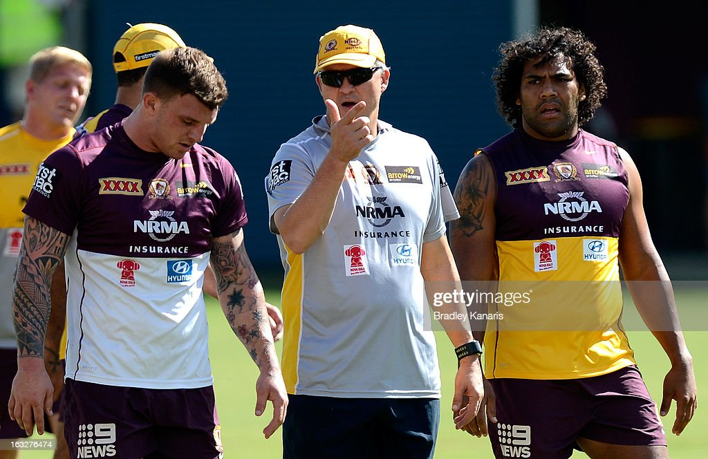 Coach Anthony Griffin gives out instructions to player Josh McGuire (L) and Sam Thaiday (R) during a Brisbane Broncos NRL training session on March 7, 2013 in Brisbane, Australia.