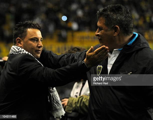 Coach Antonio Mohamed of Colon greets Coach Claudio Borghi of Boca Juniors during a match as part of the IVECO Bicentenario Apertura 2010 at La...