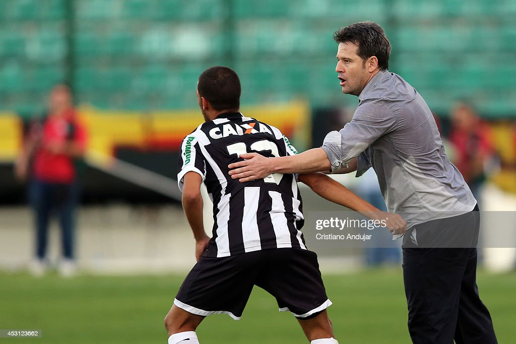 Coach Argel Fucks congratulates Clayton #13 of Figueirense for his goal, second of Figueirense in match, during a match between Figueirense and Sport as part of Campeonato Brasileiro 2014 at Orlando Scarpelli Stadium on August 3, 2014 in Florianopolis, Brazil