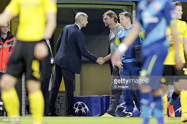 coach Arsene Wenger of Arsenal FC coach Jurgen Klopp of Borussia Dortmund during the UEFA Champions League group D match between Borussia Dortmund...