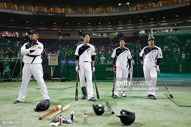 Coach Atsunori Inaba Outfielder Shogo Akiyama Infielder Tetsuto Yamada and Infielder Nobuhiro Matsuda of Japan look on prior to the international...