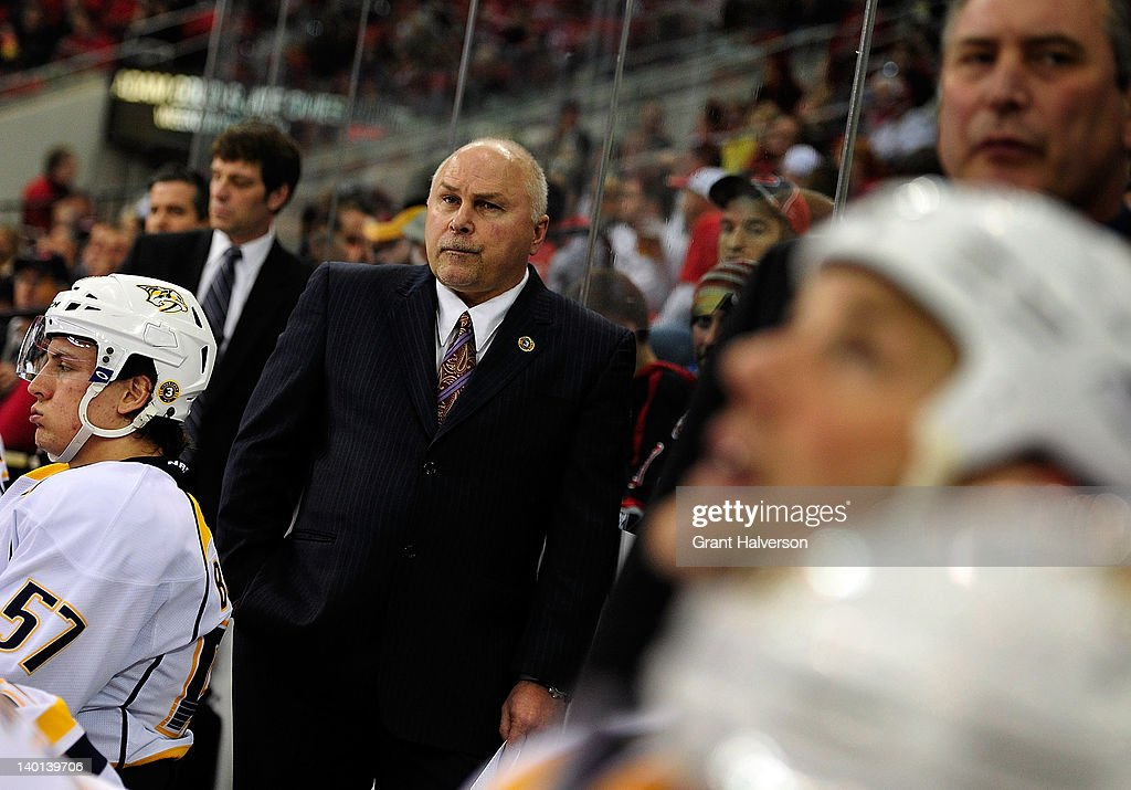 Coach <a gi-track='captionPersonalityLinkClicked' href=/galleries/search?phrase=Barry+Trotz&family=editorial&specificpeople=212800 ng-click='$event.stopPropagation()'>Barry Trotz</a> of the Nashville Predators watches his team play against the Carolina Hurricanes during play at the RBC Center on February 28, 2012 in Raleigh, North Carolina.