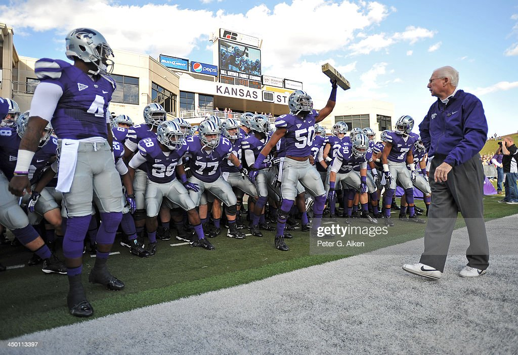 Coach Bill Snyder (R) of the Kansas State Wildcats looks on, as the Wildcats get ready to take the field before a game against the TCU Horned Frogs on November 16, 2013 at Bill Snyder Family Stadium in Manhattan, Kansas. Kansas State defeated TCU