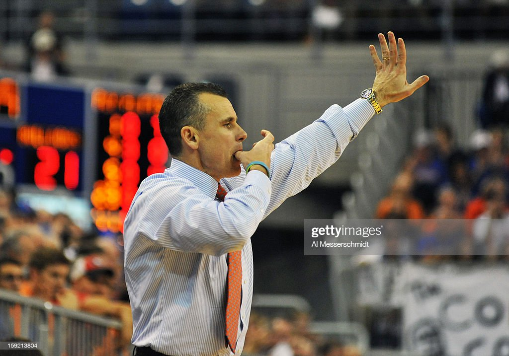 Coach <a gi-track='captionPersonalityLinkClicked' href=/galleries/search?phrase=Billy+Donovan&family=editorial&specificpeople=198944 ng-click='$event.stopPropagation()'>Billy Donovan</a> of the Florida Gators directs play against the Georgia Bulldogs January 9, 2013 at Stephen C. O'Connell Center in Gainesville, Florida. Florida won 77 - 44.