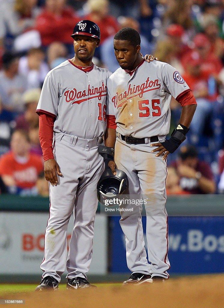 Coach Bo Porter #16 of the Washington Nationals stands with Eury Perez #55 during the game against the Philadelphia Phillies at Citizens Bank Park on September 27, 2012 in Philadelphia, Pennsylvania. The Nationals won 7-3.