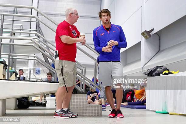Coach Bob Bowman talks with Michael Phelps during the Longhorn Aquatics Elite Invite on June 5 2016 in Austin Texas