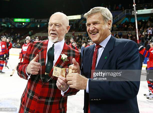 Coach Bobby Orr of Team Orr receives $100 from coach Don Cherry of Team Cherry during the CHL/NHL Top Prospects Game January 28 2016 at Pacific...
