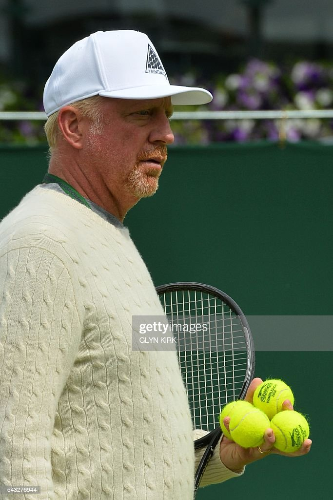Coach Boris Becker (L) watches as Serbia's Novak Djokovic (unseen) practices on court 15 ahead of his men's singles first round match against Britain's James Ward on the first day of the 2016 Wimbledon Championships at The All England Lawn Tennis Club in Wimbledon, southwest London, on June 27, 2016. / AFP / GLYN