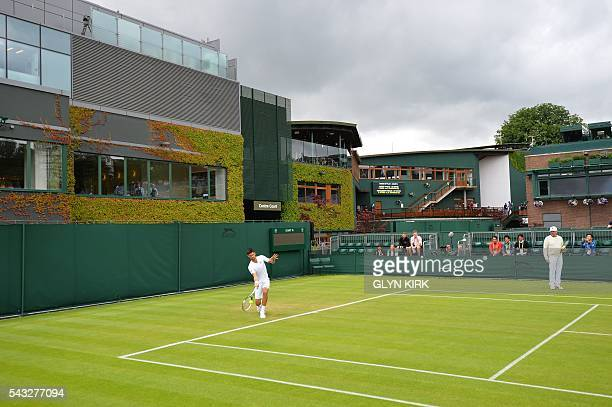 Coach Boris Becker watches as Serbia's Novak Djokovic practices on court 15 ahead of his men's singles first round match against Britain's James Ward...