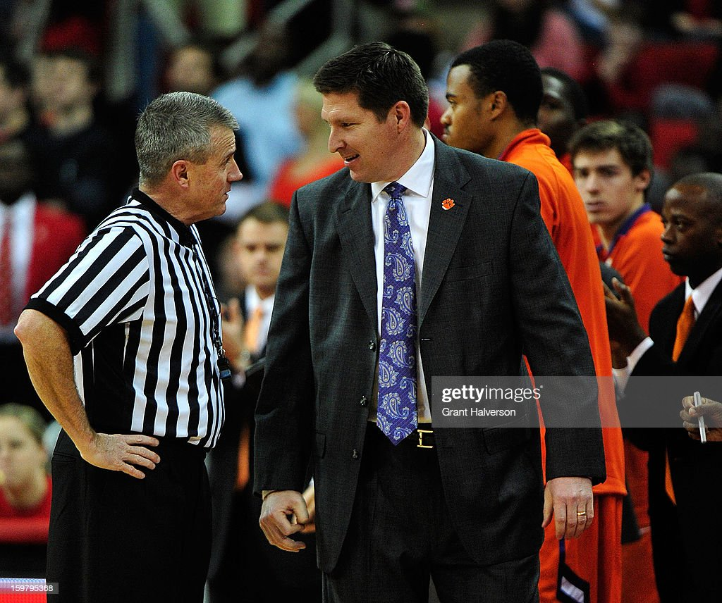 Coach <a gi-track='captionPersonalityLinkClicked' href=/galleries/search?phrase=Brad+Brownell&family=editorial&specificpeople=805140 ng-click='$event.stopPropagation()'>Brad Brownell</a> of the Clemson Tigers discusses a call with official Bryan Kersey during play against the North Carolina State Wolfpack at PNC Arena on January 20, 2013 in Raleigh, North Carolina.