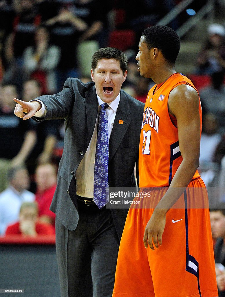 Coach <a gi-track='captionPersonalityLinkClicked' href=/galleries/search?phrase=Brad+Brownell&family=editorial&specificpeople=805140 ng-click='$event.stopPropagation()'>Brad Brownell</a> yells at Damarcus Harrison #21 of the Clemson Tigers during a loss to the North Carolina State Wolfpack at PNC Arena on January 20, 2013 in Raleigh, North Carolina. North Carolina State won 66-62.