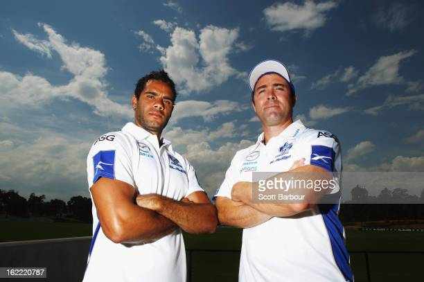 Coach Brad Scott and Daniel Wells of the Kangaroos pose during a North Melbourne Kangaroos AFL press conference at Aegis Park on February 21 2013 in...