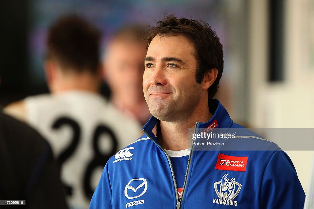 Coach Brad Scott arrives to speak to media during a North Melbourne Kangaroos AFL training session at Arden Street Ground on May 13 2015 in Melbourne...