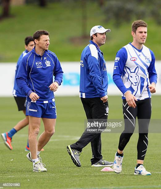 Coach Brad Scott looks on during a North Melbourne Kangaroos AFL media session at Arden Street Ground on July 16 2014 in Melbourne Australia
