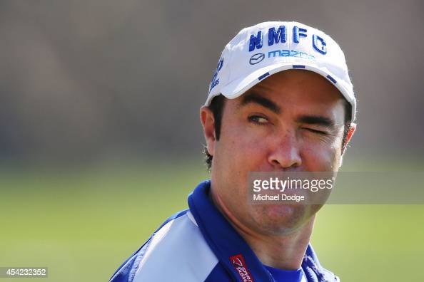 Coach Brad Scott winks at a fan after being wished well for the finals during a North Melbourne Kangaroos AFL training session at Arden Street Ground...