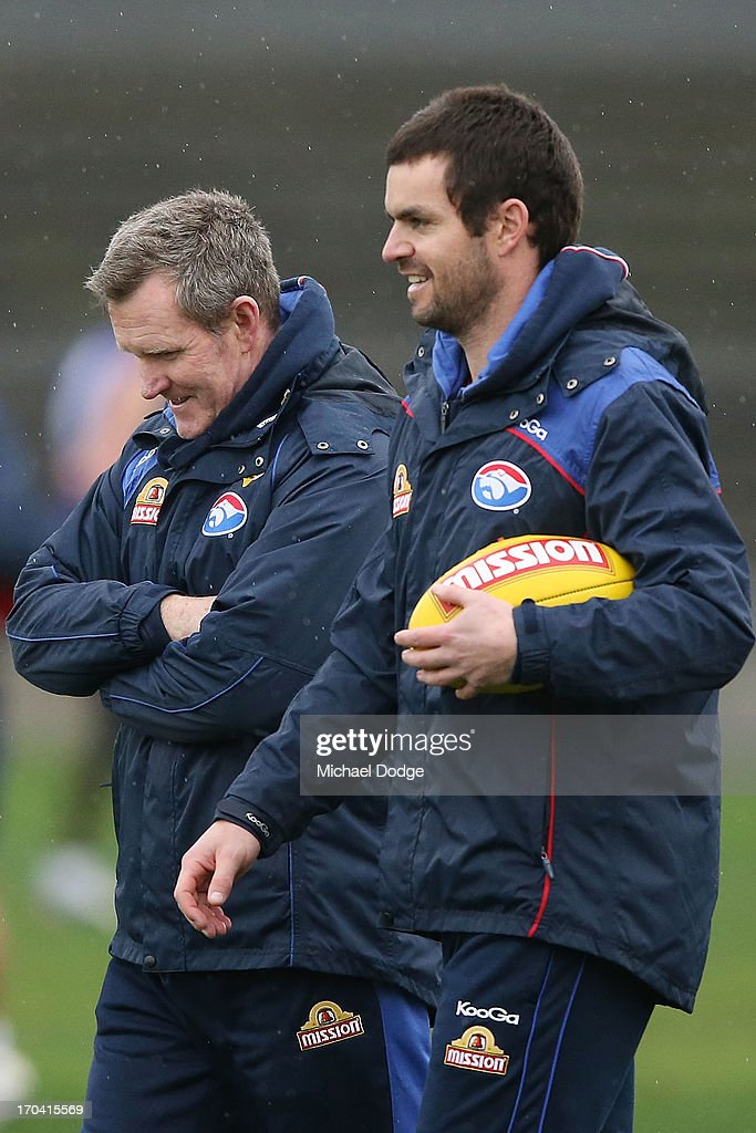 Coach Brendan McCartney (L) walks with assistant coach Matthew Scarlett during a Western Bulldogs AFL training session at Whitten Oval on June 13, 2013 in Melbourne, Australia.