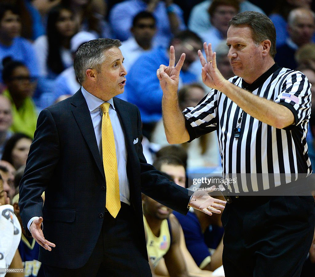 Coach Brian Gregory of the Georgia Tech Yellow Jackets argues with official Gary Maxwell after a foul was called against his team during a loss to the North Carolina Tar Heels at the Dean Smith Center on January 23, 2013 in Chapel Hill, North Carolina. North Carolina won 79-63.
