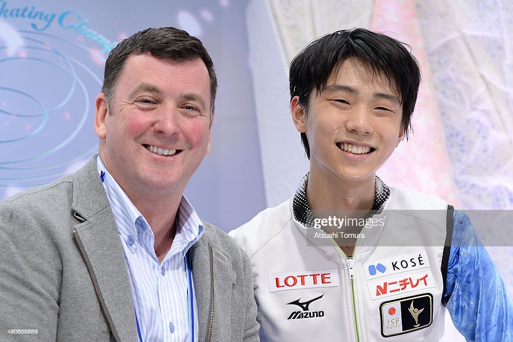 Coach <a gi-track='captionPersonalityLinkClicked' href=/galleries/search?phrase=Brian+Orser&family=editorial&specificpeople=1138867 ng-click='$event.stopPropagation()'>Brian Orser</a> and Yuzuru Hanyu of Japan smiles after the Men's Short Program during ISU World Figure Skating Championships at Saitama Super Arena on March 26, 2014 in Saitama, Japan.