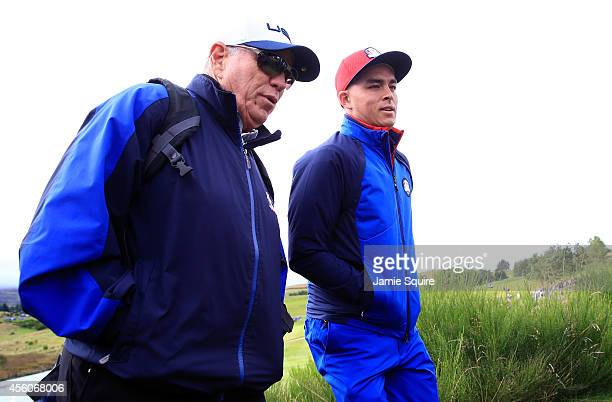 Coach Butch Harmon talks to Rickie Fowler of the United States during practice ahead of the 2014 Ryder Cup on the PGA Centenary course at the...