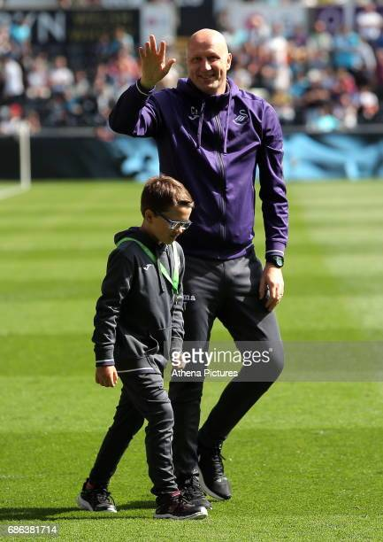 Coach Cameron Toshack of the Swansea U23 team waves to supporters during the Premier League match between Swansea City and West Bromwich Albion at...