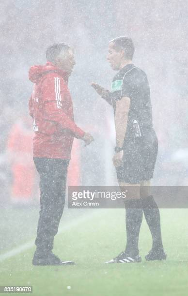 Coach Carlo Ancelotti of Bayern Muenchen talks with referee Tobias Stieler during the Bundesliga match between FC Bayern Muenchen and Bayer 04...