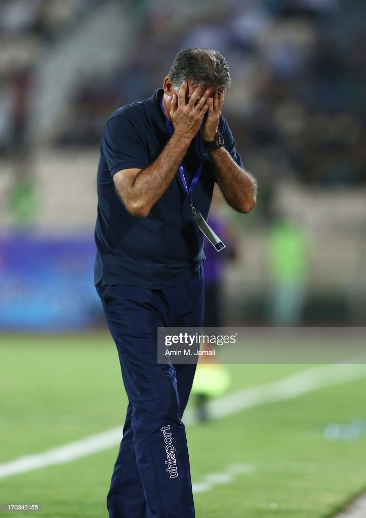 Coach <a gi-track='captionPersonalityLinkClicked' href=/galleries/search?phrase=Carlos+Queiroz&family=editorial&specificpeople=211586 ng-click='$event.stopPropagation()'>Carlos Queiroz</a> of Iran reacts during FIFA World Cup Asian Qualifier between Iran and Lebanon at Azadi Stadium on June 11, 2013 in Tehran, Iran.