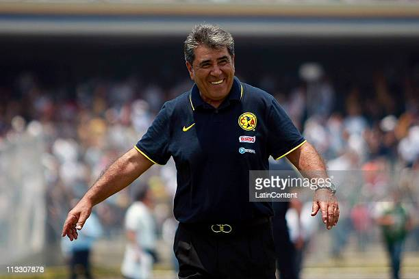 Coach Carlos Reinoso of America celebrates victory over Pumas during their match as part of the Clausura 2011 at Olympic Stadium on May 1 2011 in...