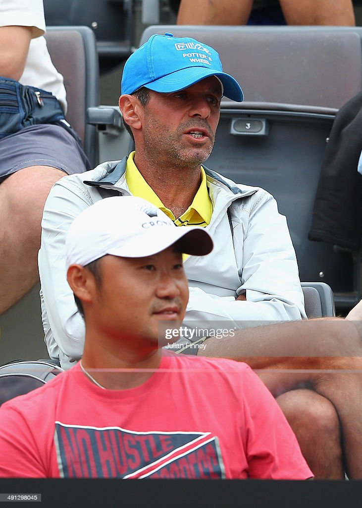 Coach Carlos Rodriguez and husband Jiang Shan of Li Na of China watch on in her match against Sara Errani of Italy during day six of the...