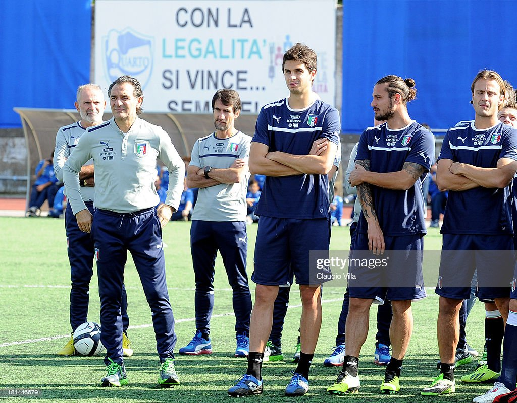Coach Cesare Prandelli of Italy and players look on before of a training session, ahead of their FIFA World Cup qualifier against Armenia, on October 14, 2013 in Naples, Italy. The training session was organised at Quarto, a football pitch built on land confiscated from the Camorra - the Neapolitan Mafia, as part of the fight against the mafia.