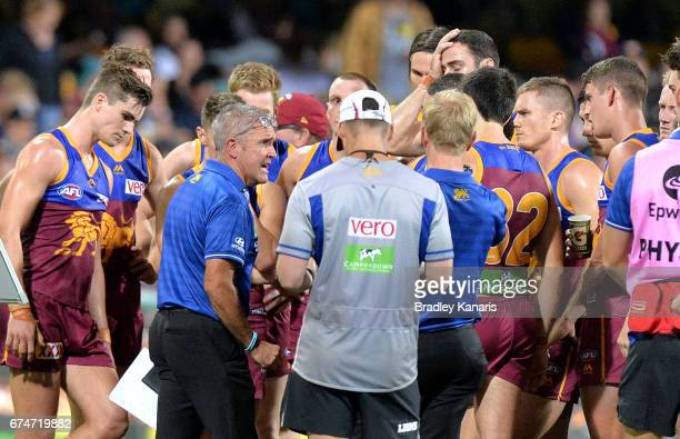 Coach Chris Fagan of the Lions talks to his players at the 3rd quarter break during the round six AFL match between the Brisbane Lions and the Port...