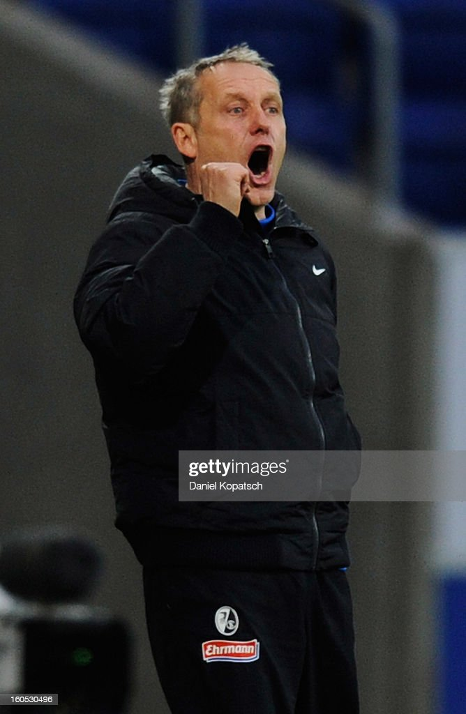 Coach <a gi-track='captionPersonalityLinkClicked' href=/galleries/search?phrase=Christian+Streich&family=editorial&specificpeople=4411796 ng-click='$event.stopPropagation()'>Christian Streich</a> of Freiburg reacts during the Bundesliga match between TSG 1899 Hoffenheim and Sc Freiburg at Rhein-Neckar-Arena on February 2, 2013 in Sinsheim, Germany.