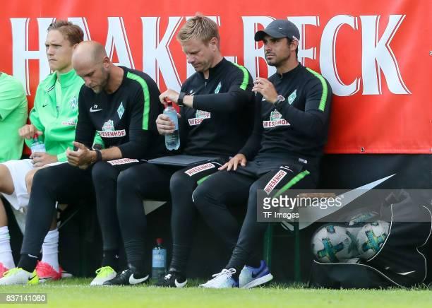 coach Christian Vander of Bremen Cocoach Markus Feldhoff of Bremen and Head coach Alexander Nouri of Bremen sits on the bench during the preseason...