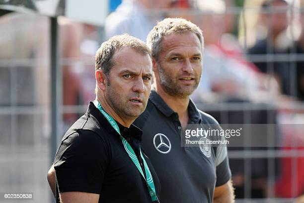Coach Christian Wueck of Germany and DFB manager Hansi Flick react prior the Under 17 four nations tournament match between U17 Germany and U17 Italy...