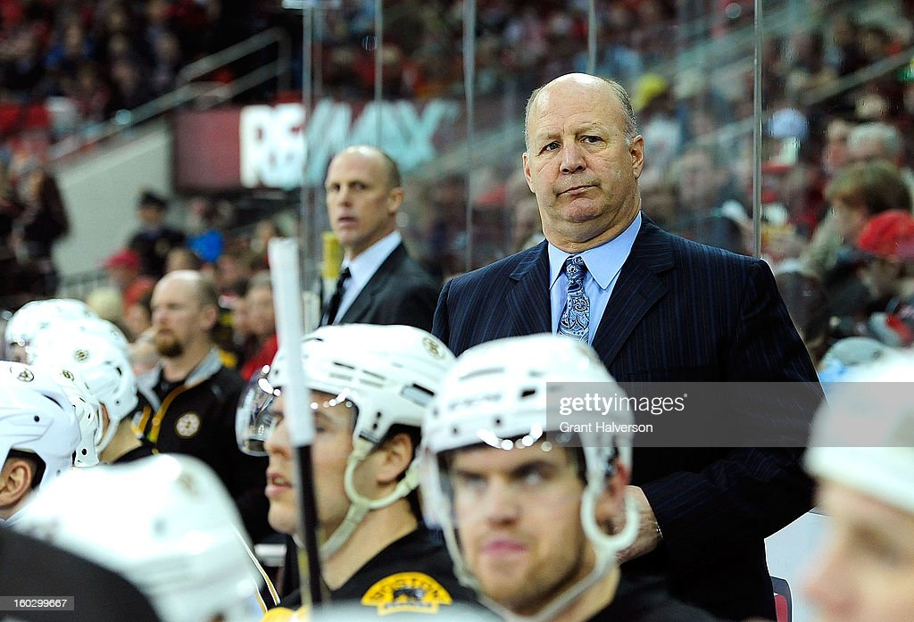 Coach <a gi-track='captionPersonalityLinkClicked' href=/galleries/search?phrase=Claude+Julien&family=editorial&specificpeople=582124 ng-click='$event.stopPropagation()'>Claude Julien</a> of the Boston Bruins watches his team in action against the Carolina Hurricanes at PNC Arena on January 28, 2013 in Raleigh, North Carolina.