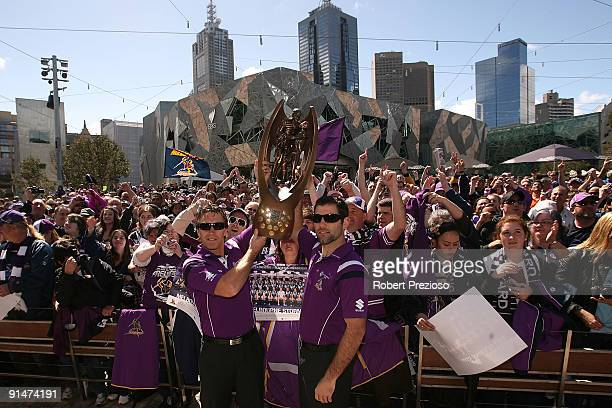 Coach Craig Bellamy and Captain Cameron Smith of the Melbourne Storm hold the NRL Premiership trophy aloft in front of fans during a Civic Reception...