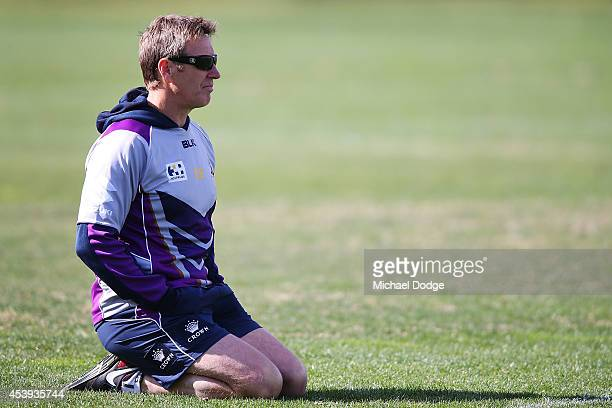Coach Craig Bellamy looks on during a Melbourne Storm NRL training session at Gosch's Paddock on August 22 2014 in Melbourne Australia