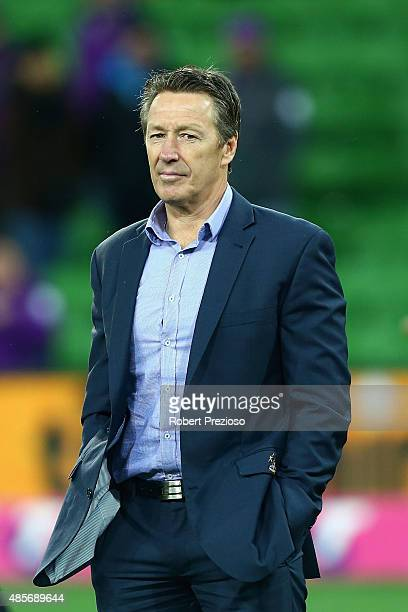 Coach Craig Bellamy of the Storm looks on after a win during the round 25 NRL match between the Melbourne Storm and the North Queensland Cowboys at...