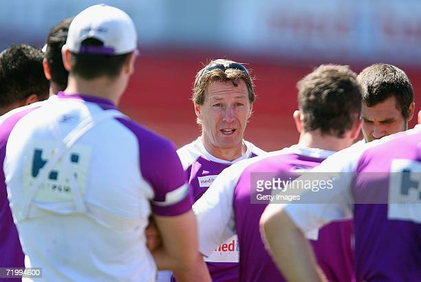 Coach Craig Bellamy tallks to players during the Melbourne Storm open training session at MC Labour Park September 26 2006 in Melbourne Australia The...