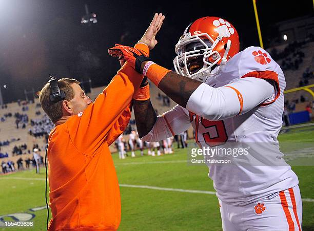 Coach Dabo Swinney and Isaiah Battle of the Clemson Tigers celebrate after touchdown against the Duke Blue Devils during play at Wallace Wade Stadium...