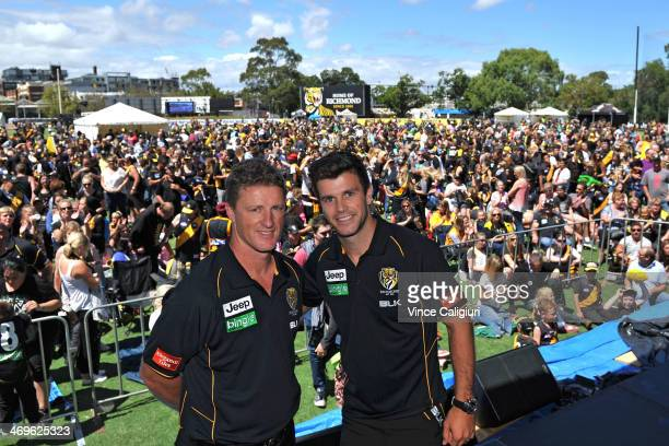 Coach Damien Hardwick and captain Trent Cotchin pose for photo in front of fans during the Richmond Tigers AFL Family Day on February 16 2014 in...